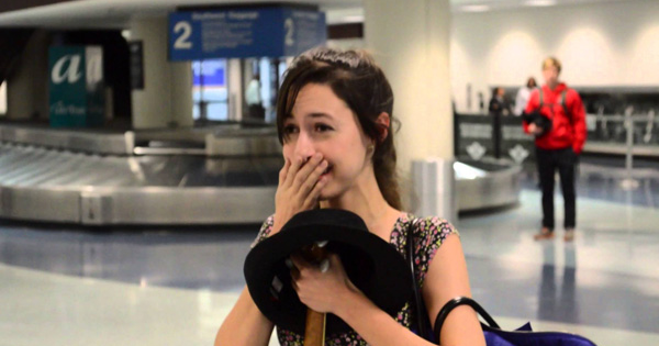 A Group Of Musical Friends Help A Man Propose To His Girlfriend At The Airport.
