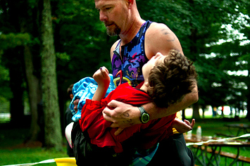 Dad Runs Triathlon While Carrying Daughter Suffering From Cerebral Palsy