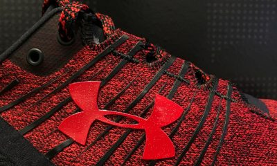 Under Armour cuts revenue forecast; federal probe weighs on shares