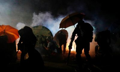 Highlights: Hong Kong on edge as violence spreads