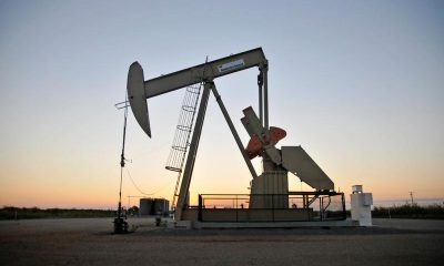 UPDATE 7-Oil up on economic recovery hopes, COVID-19 keeps prices in check